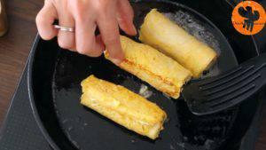 Đam Mê Ẩm Thực Cho-bánh-mì-đã-cuộn-ở-bước-3-lăn-qua-hỗn-hợp-trứng-ở-bước-4.-Đặt-lên-chảo-rán-và-lật-đều-tay-cho-đến-khi-lớp-vỏ-có-màu-nâu-vàng6-300x169